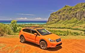 orange subaru forester driven 2013 subaru xv crosstrek winding road