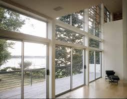 full exterior sliding glass door for modern riverside house design