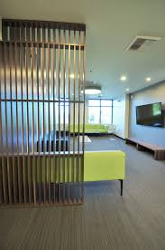 tanasbourne family dental modern waiting room wood slat wall