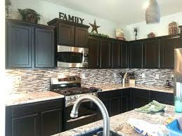 whats on top of your kitchen cabinets home decorating top of cabinet decor murphysbutchers com