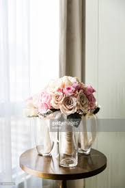 Vases Of Roses Bridal Bouquets Of Pink And Cream Roses In Vases On Table By A