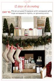 holiday how to decorate day 10 fill your fireplace with something festive