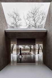archstudio designs buddhist shrine into a small mound in hebei