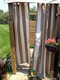 outdoor shower with striped curtain spaces gardens bathroom outside shower designs feel the experience showering outdoor stripes curtain ideas for small with hanging potted