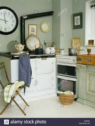 white aga and white gas oven in pale gray cottage kitchen with