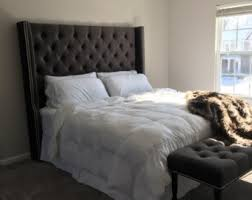 diamond tufted slightly arched wingback headboard and bench