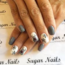 cute reindeer with big red nose and snow flakes christmas nails