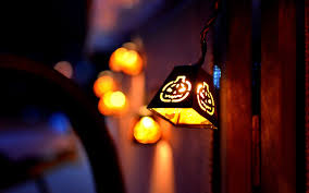 orange halloween hd background textured halloween lantern city night holidays lights bokeh hd wallpaper