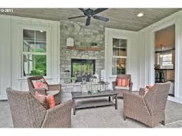 Sided Outdoor Fireplace - indoor outdoor fireplace in cute covered porch with paneled walls
