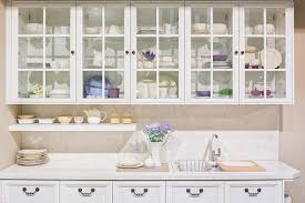 glass shelf between kitchen cabinets how to utilize glass in cabinetry and shelving