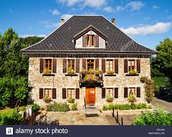 traditional french house with flowers and wooden windows stock