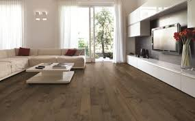 contemporary family room with medium stained maple floors