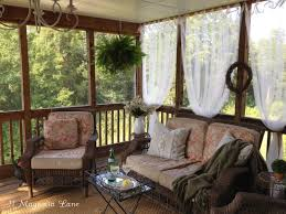 screen porch decorating ideas inexpensive sheer curtains add privacy to screened porch 11