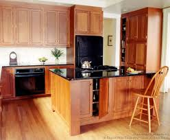 light wood kitchen cabinets with black countertops kitchens with light wood cabinets and black countertops