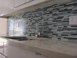 interior kitchen sky blue glass subway tile backsplash with dark