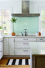 glossy mint green tile backsplash giant stainless steel range hood