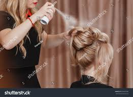 usinghair cls professional hairdresser using hair spray on stock photo 659987590