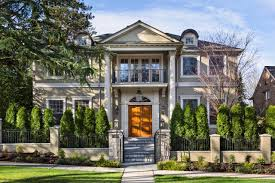 with a full height front porch tall columns and a strong sense of