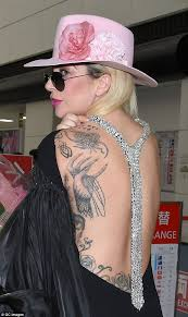 lady gaga shows off her intricate back tattoos as she lands in