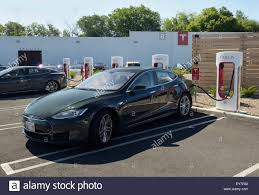 tesla dealership electric car charging station with a tesla sedan plugged in tesla
