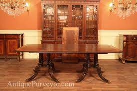 mahogany dining table with crossbanded crotch mahogany field