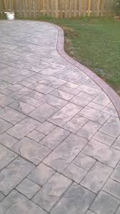 Covering Old Concrete Patio by Ashlar Slate Stamped Concrete Patio With Colour Hardener Border