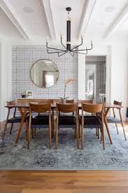 dining room table decor and the whole gorgeous dining vintage modern dining room photo by amy bartlam design by veneer