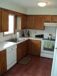 oak kitchen cabinets with black appliances oak kitchen cabinets