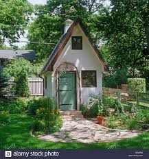 white tudor style garden shed with stone pathway eeap93 jpg 1300 white tudor style garden shed with stone pathway