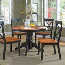 5 pc round pedestal dining table home styles 5 pc round pedestal table black cottage oak finish
