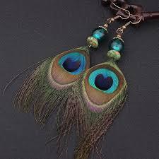 peacock feather earrings s tribal peacock feather earrings spirit magic