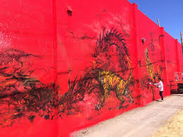that s why he picked fighting dragon and tiger the competition this isn t the largest mural hua tunan has ever painted