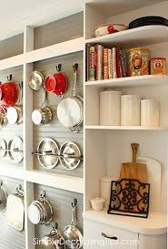 Kitchen Cabinet Pot Organizer Diy Wall Mounted Pot Rack From A Shallow Display Cabinet Open