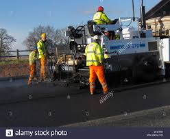 a civil engineering contractor highway maintenance gang laying