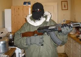 gas mask costume bomb scare as dressed in camouflage with gas mask and