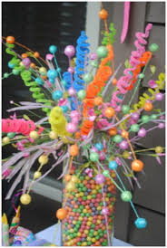 Rainbow Centerpiece Ideas by Rainbow Table Display With Coloured Balls And Pipe Cleaners