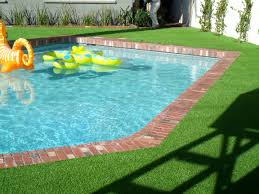 beautiful green grass to match up with your pool all year round