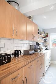 a bright and clean kitchen refresh with wickes a mummy too suddenly our once tired kitchen is bright and beautiful again the gleaming tiles and glossy paintwork are complimented by the matt grey of the grout and