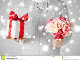 man holding bouquet of flowers and gift box royalty free stock