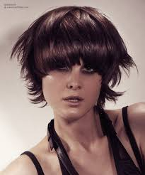 feather hair styles for men short feathered haircut with wispy tips and a curved fringe