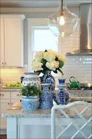 dark blue kitchen cabinets belgian blue fossil worktops and a