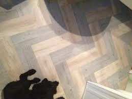 i used two different colors of vinyl plank flooring cut the