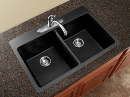sink black granite countertop brown tile backsplash french