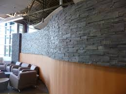 how to installed stacked stone panels on curved walls