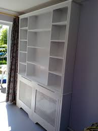15 photo of radiator covers and bookcases