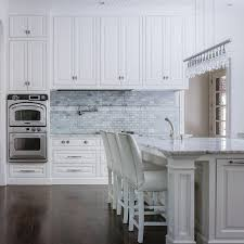Raised Panel Cabinet With Nuance by Ivory Kitchen Cabinets With Carrera Marble Countertop And