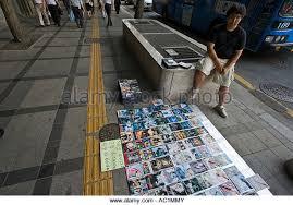 vendor selling movies stock photos u0026 vendor selling movies stock