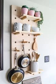 962 best kitchens images on pinterest kitchen kitchen ideas and how to make a diy pot rack from oversized pegboard shelves