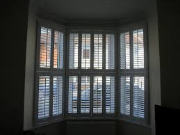 curtain rod for bay window home depot design ideas idolza bay window shutters hampshire dorset shuttersouth fitted in portsmouth teenage girl room themes unusual