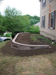 i built a small retaining wall and created a two tier garden diy